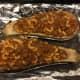 Spoon meat-macaroni mixture into eggplant halves