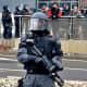 Policeman carries a pepper spray rifle