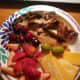 Grilled Turkey breast cut into chunks, cherries, cheese slices and a couple of olives
