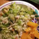 Parmesan salad with orange slices on the side