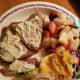 Grilled Salmon fillets topped with Alloette cheese, zuchini with cheese and onion bake, fruits