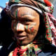 A Pondo man, in Tanzania, in full regalia and face paintings
