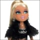 """A Bratz doll - if this is not a hooker with botox lips I don't know what is. Check out the """"Babe"""" belly shirt. Call me old fashioned but at least Barbie had some class."""
