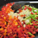 Saute the onions and peppers until softened