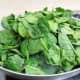 Add the fresh spinach leaves to the pan with the onions.