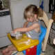 """Young """"Flour Child"""" at work in the kitchen"""