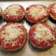 Next spread the mozzarella cheese on top of the eggplant slices.