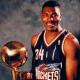 Hakeem Olajuwon with the NBA Championship Trophy.