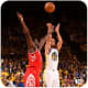 Stephen Curry shoots over James Harden of the Houston Rockets.