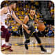 Stephen Curry driving to the basket while Kevin Love of the Cleveland Cavaliers defends.