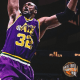 Karl Malone soaring high for a gigantic dunk.