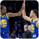 Stephen Curry high fives his teammate Kevin Durant.