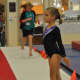 Gymnast at attention - awaiting start of Level 5 floor routine