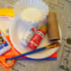 The supplies to make a toilet paper roll apple core.