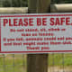 """Not quite as good as the old """"Please do not annoy, torment, pester, plague, molest, worry, badger, [etc, etc] the animals"""" San Diego Zoo signs, but cute."""