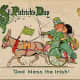 """Vintage kids: Boy and girl kissing while riding in a donkey cart """"Erin go Bragh"""""""