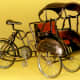 """Three cycle miniature, famous with the name """"becak"""" in Indonesia"""