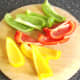 Bell pepper halves are roughly chopped for stock