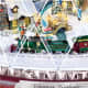 Miniature animated train circles the Christmas village.