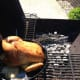 This gives you a better view of what I mean by indirect heat.  You'll want to close the top of the grill and check on your chicken and fire every 10 to 15 minutes.
