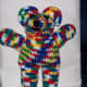 """Crocheted """"crayon"""" color ombre yarn for a wild colored bear."""