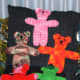 """All around 10-12"""" tall, a variety of knit colorful teddy bears."""