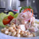 Halibut ceviche piled high and served with beans.