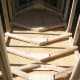 After each rafter pair is connected it is braced at the joint with one or two pieces of plywood cut to the proper angle.