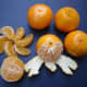 Whole, peeled, half, and clementine sections were photographed by carol on November 7. 2007.