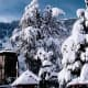 """The snow covered """"Chaurasi"""" or 84 temples complex at Bharmour"""