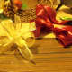 """Gold ribbon cut 2 pieces 15"""" make bows and wire them together. Puff out the wire ribbon bow."""