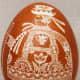 Shepherd motif on scratchwork or etched egg.