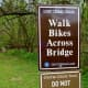 This sign signaled that we were entering another park after crossing a bridge over the creek.