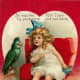 Cute kids: little girl with parrot Valentine's Day card