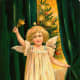 Free vintage angel with green velvet curtains