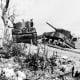 Two knocked out Sherman tanks on bloody ridge Okinawa May 1945.