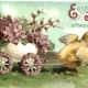 Baby chick pulling Easter egg cart full of flowers