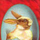 Vintage Easter cards: Easter bunny coming out of a blue Easter egg