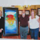 My Wife and I Standing Next to Peter Max and One of His Paintings That We Didn't Buy.  It was $ 60,000 for goodness sakes. (He brings his own photographer, by the way.)