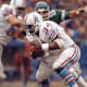 Earl Campbell, Houston Oilers 1980 - 1,934 yards.