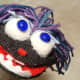 I made funny eyeballs using polished stones. I easily glued them to puff balls from an old Christmas Stocking, and then to the Puppets face! Just look at all of that personality!