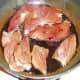 Lamb heart is added to the pan with the liver