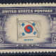 """This U.S. stamp is an example of a printing error.  The name under the flag should be """"Korea"""", but has a plate flaw that makes it into """"Korpa""""."""