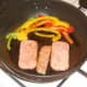 Spam slices are fried with bell peppers