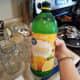 Step 19: Add 2 tablespoons of lemon juice to each quart jar.