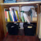The waste bins slid underneath the new shelving.  General waste on the left, and confidential waste on the right
