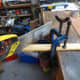 Using a hand saw to cut the correct angle for the wooden facings