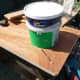Using a large paint pot to mark out the curve for the inner corner of the unit