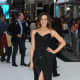 Promoting Total Recall in long black strapless gown with a thigh high slit
