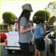 Megan Fox in leggings and funky high heels getting a ticket